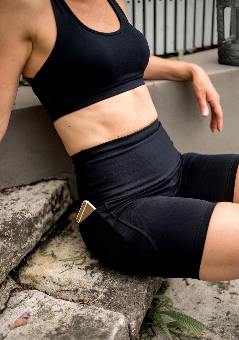 High waist black beauty pocket mid shorts close up seated
