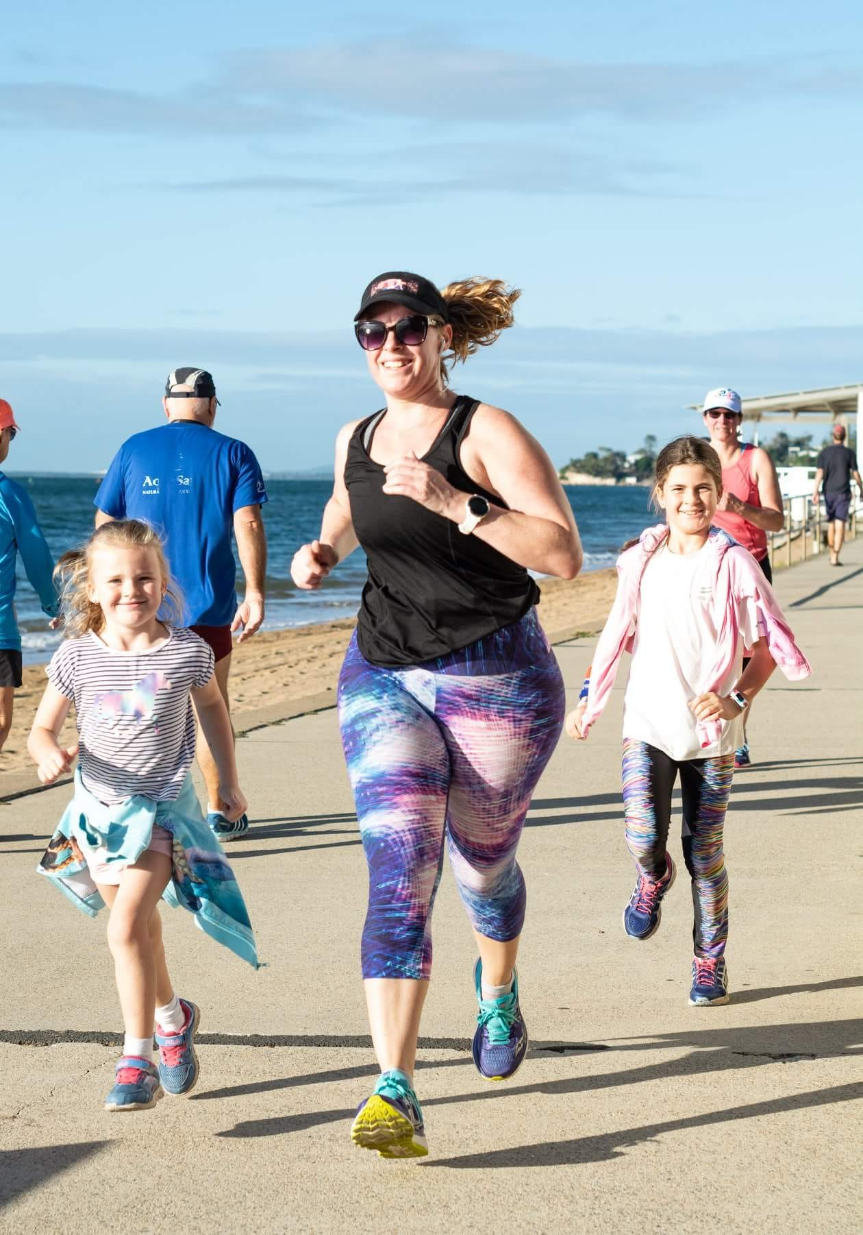 Lys Dee running with kids