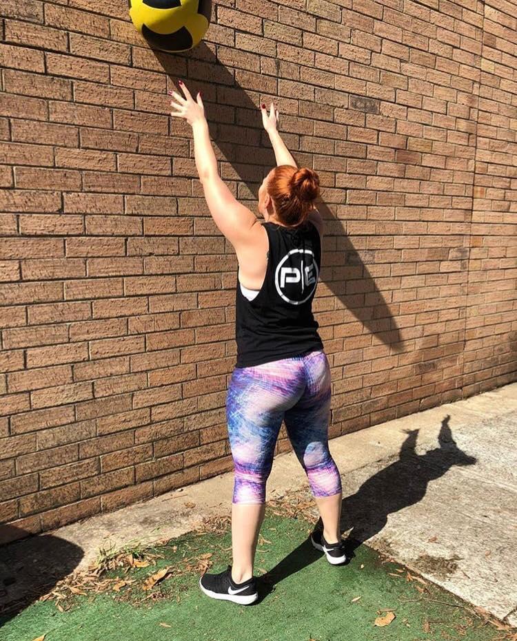 Tamara Beasley throwing a wall ball